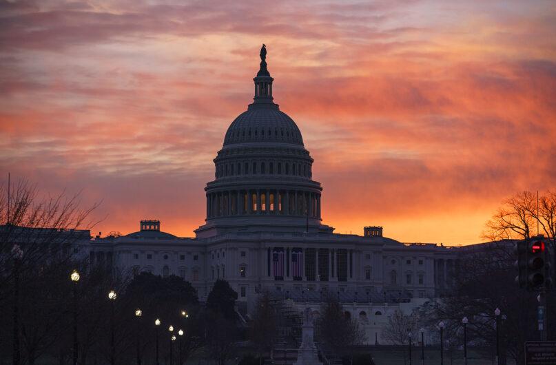 Dawn breaks at the Capitol in Washington,  Jan. 11, 2021. (AP Photo/J. Scott Applewhite)