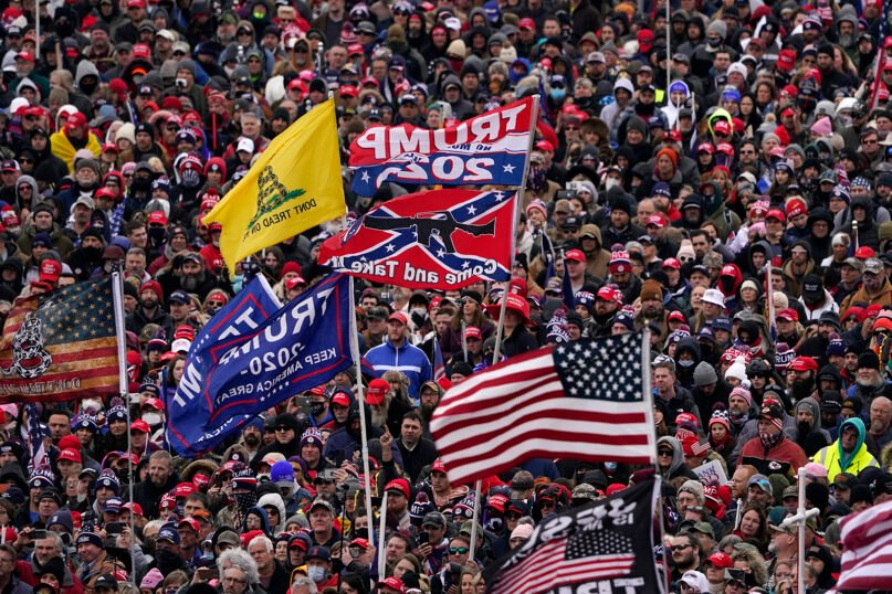 People listen as President Donald Trump speaks during a rally Jan. 6, 2021, in Washington. (AP Photo/Evan Vucci)