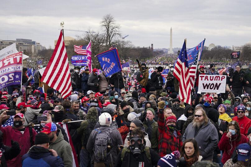 Trump supporters gather before breaching the Capitol on Jan. 6, 2021, in Washington.  (AP Photo/John Minchillo)