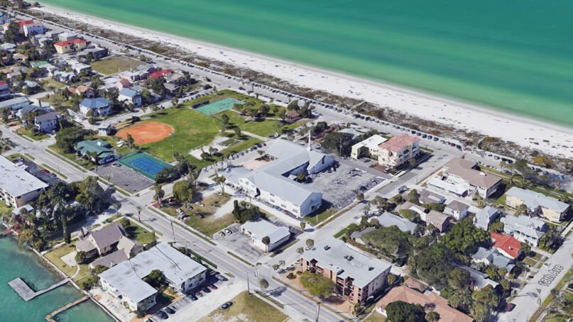 Pass-a-Grille Beach Community Church, center, and its controversial parking spaces, in St. Pete Beach, Florida. Image courtesy of Google Maps