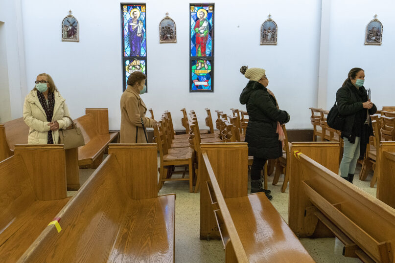 People line up next to the pews at a pop-up COVID-19 vaccination site at St. Luke's Episcopal Church, Jan. 26, 2021, in the Bronx borough of New York. (AP Photo/Mary Altaffer)