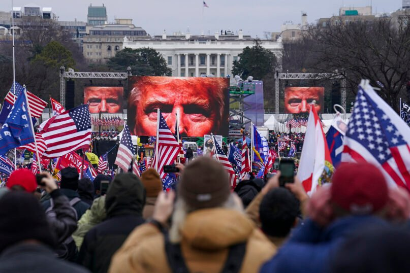 Trump supporters participate in a rally Jan. 6, 2021, in Washington. As Congress prepared to affirm President-elect Joe Biden's victory, thousands of people gathered to show their support for President Donald Trump and his baseless claims of election fraud. The president addressed the rally on the Ellipse, just south of the White House. (AP Photo/John Minchillo)