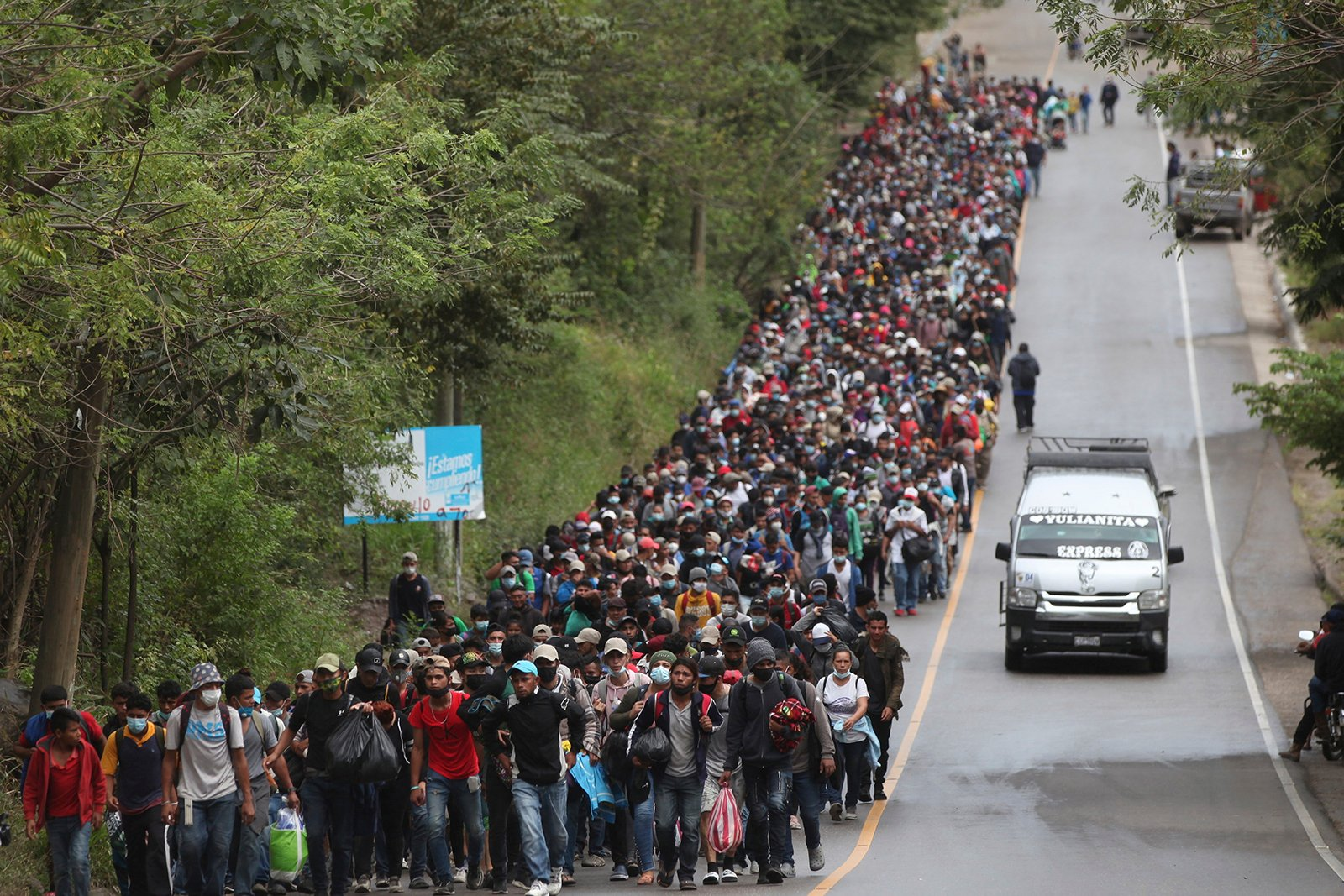 Honduran migrants hoping to reach the U.S. border walk along a highway in Chiquimula, Guatemala, on Jan. 16, 2021. Guatemalan authorities estimated that as many as 9,000 Honduran migrants have crossed into Guatemala as part of an effort to form a new caravan to reach the U.S. border. (AP Photo/Sandra Sebastian)