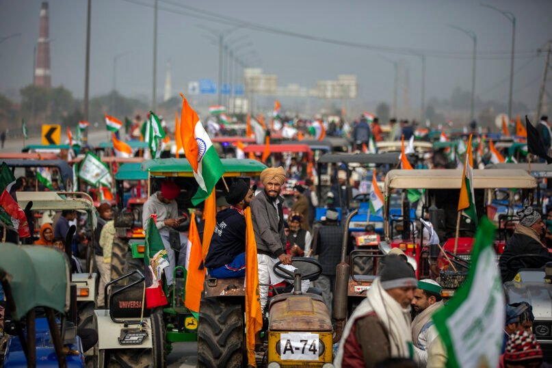 Indian farmers participate in a tractor rally in a protest against new farm laws at Ghaziabad, on the outskirts of New Delhi, on Jan. 7, 2021. India's top court temporarily put on hold the implementation of new agricultural laws and ordered the formation of an independent committee of experts to negotiate with farmers who have been protesting against the legislation. (AP Photo/Altaf Qadri, File)