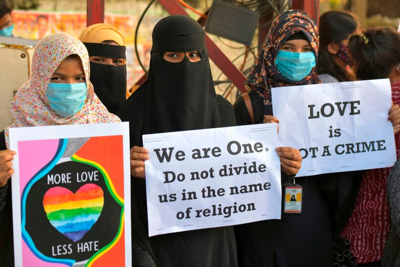 Activists protest against 'love jihad' laws being proposed, in Bangalore, India, on Dec. 1, 2020. (Photo by Manjunath Kiran/AFP via Getty Images)