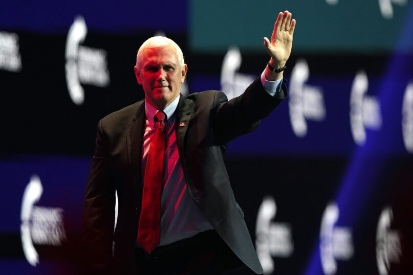 Exit, stage religious right. Vice President Mike Pence waves after speaking during the Turning Point USA Student Action Summit, Tuesday, Dec. 22, 2020, in West Palm Beach, Fla. (AP Photo/Lynne Sladky)