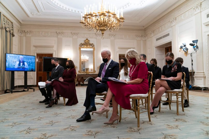 From left, Doug Emhoff, Vice President Kamala Harris, President Joe Biden and first lady Jill Biden bow their heads in prayer during a virtual Presidential Inaugural Prayer Service, in the State Dinning Room of the White House, on Jan. 21, 2021, in Washington. (AP Photo/Alex Brandon)