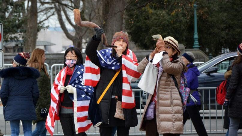 Women blow shofars during the Jericho March on Jan. 5, 2020, in Washington. RNS photo by Jack Jenkins