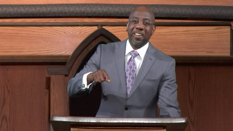 The Rev. Raphael Warnock preaches at Ebenezer Baptist Church on Jan. 24, 2021, in Atlanta. Video screengrab