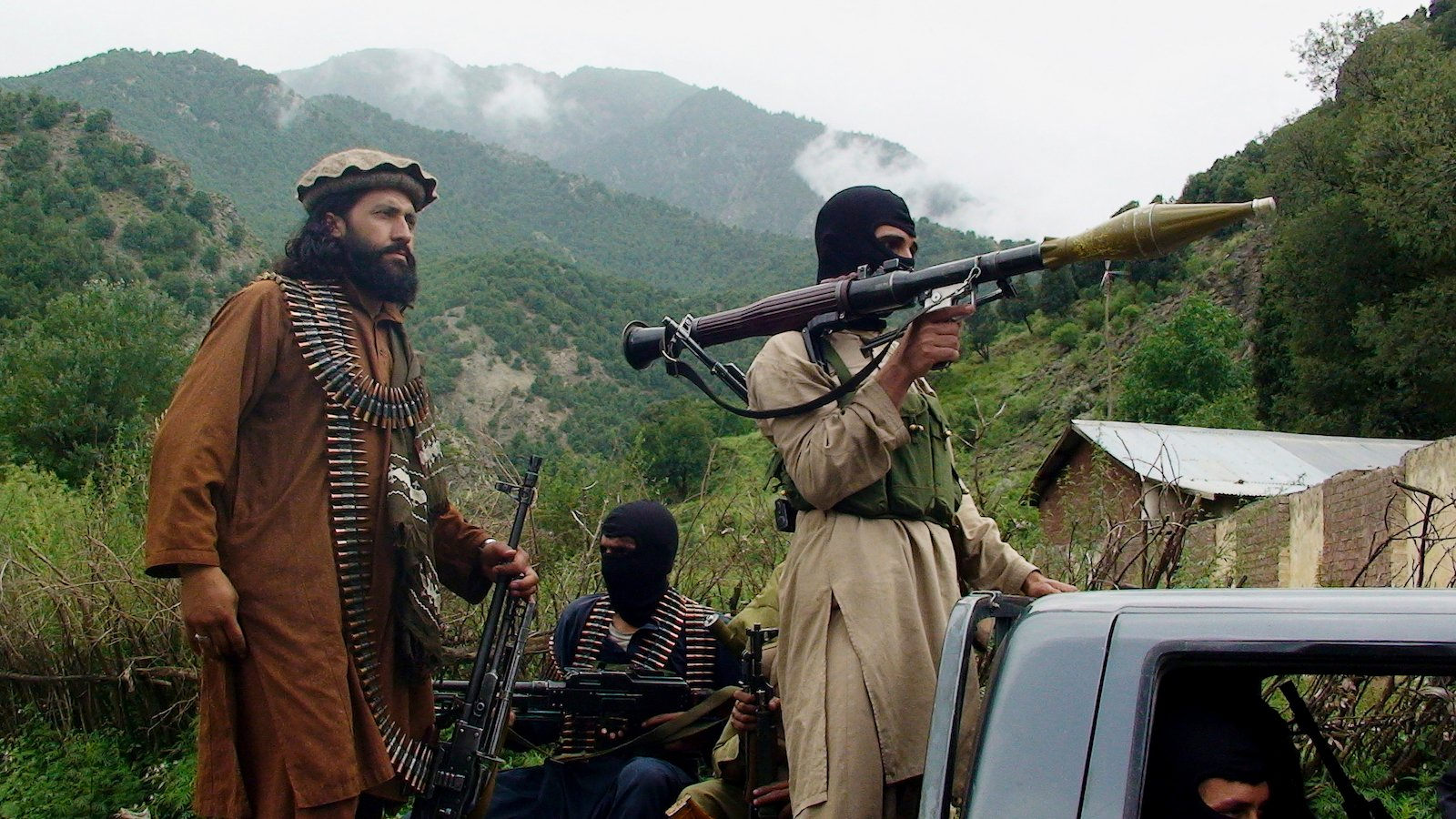FILE - In this Aug. 5, 2012 file photo, Pakistani Taliban patrol in their stronghold of Shawal in Pakistani tribal region of South Waziristan. Militant attacks are on the rise in Pakistan amid a growing religiosity that has brought greater intolerance, prompting one expert to voice concern the country could be overwhelmed by religious extremism. (AP Photo/Ishtiaq Mahsud, File)