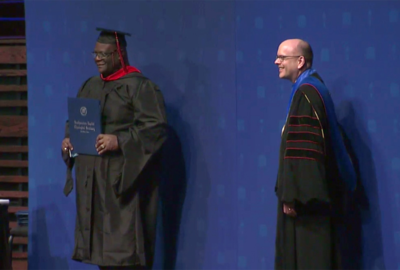 The Rev. Dwight McKissic, left, poses for a graduation photo with Southwestern Baptist Theological Seminary president Adam Greenway in December 2020. Video screengrab courtesy of SWBTS