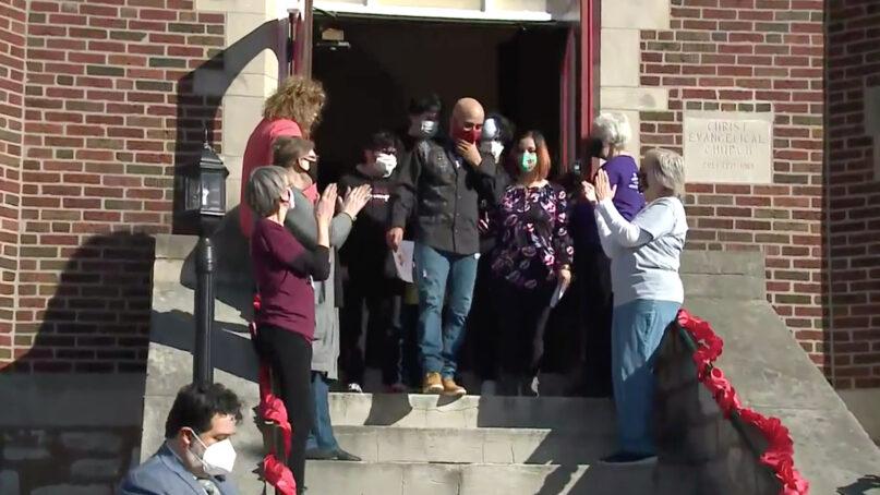 A crowd cheers while Rene Alex Garcia Maldonado, center, exits Christ Church United Church of Christ in Maplewood, Missouri, as he leaves sanctuary, Wednesday, Feb. 24, 2021. Video screengrab via KMOV