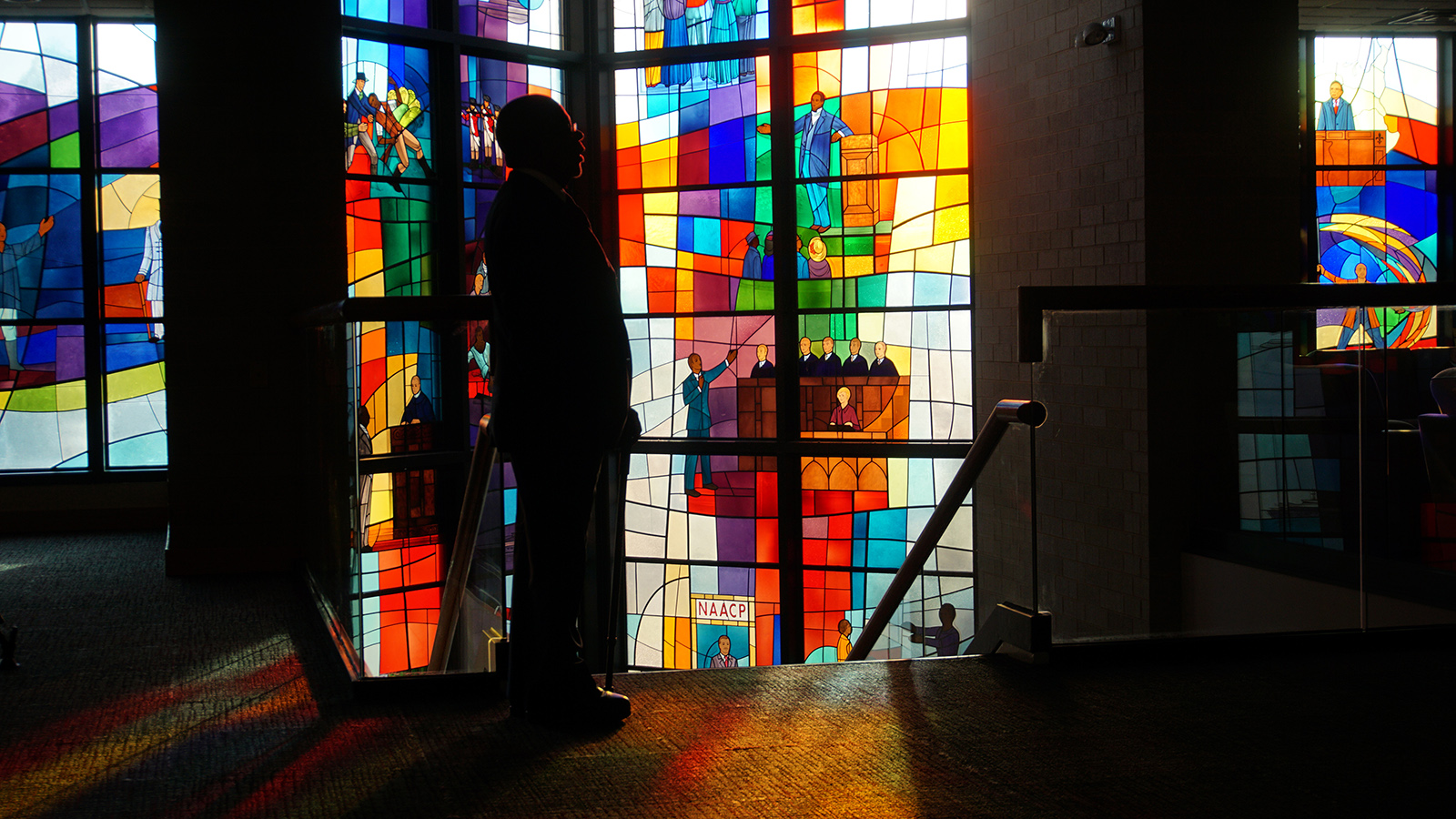 Henry Louis Gates Jr. stands in front of stained glass at Trinity United Church of Christ in Chicago. Photo courtesy of McGee Media