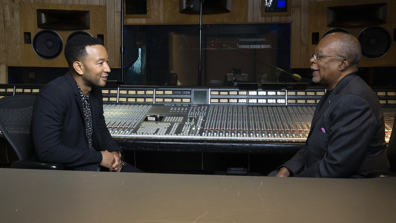 """Host, Henry Louis Gates Jr., right, speaks to recording artist John Legend while filming the series """"The Black Church: This is Our Story, This is Our Song,"""" which premieres February 16 on PBS. Photo courtesy of McGee Media"""