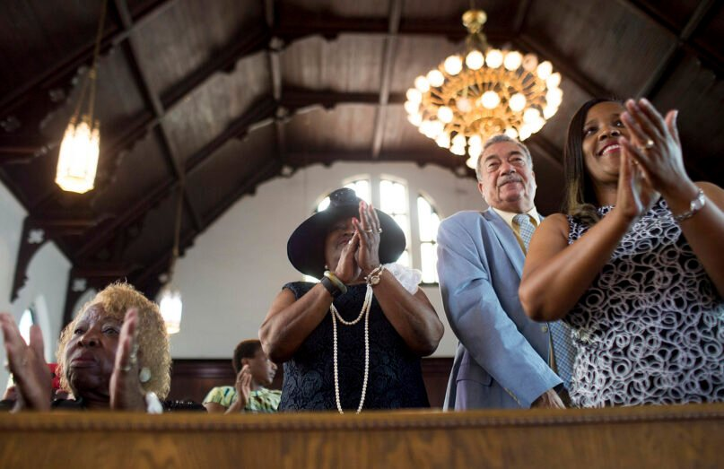 Worshippers clap during a 2016 service at the First Baptist Church, a predominantly African-American congregation, in Macon, Georgia. (AP Photo/Branden Camp)