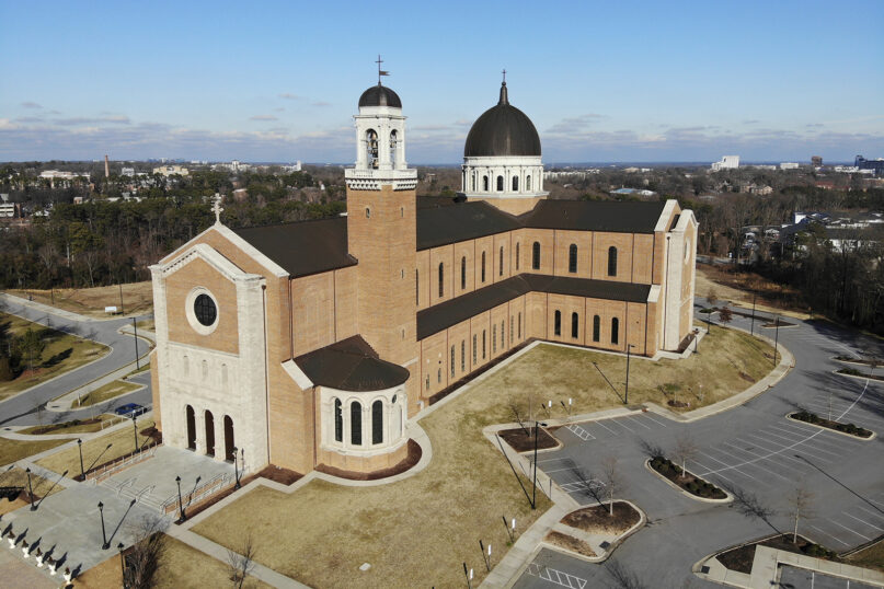 An aerial view of the Holy Name of Jesus Cathedral in Raleigh, N.C., Wednesday, Jan. 27, 2021. Overall, the nearly 200 dioceses in the U.S. and other Catholic institutions received at least $3 billion from the federal government's small business emergency relief program. That makes the Roman Catholic Church perhaps the biggest beneficiary of the paycheck program, according to data the U.S. Small Business Administration released following a public-records lawsuit by AP and other news organizations. (AP Photo/Allen G. Breed)