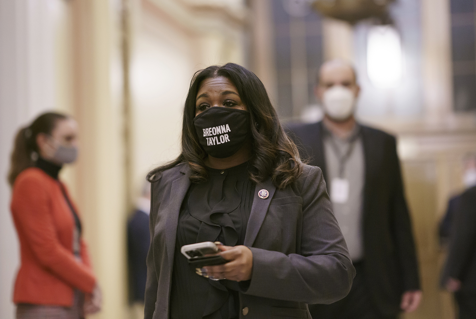 FILE - In this Feb. 4, 2021 file photo, Rep. Cori Bush, D-Mo., arrives at the House chamber at the Capitol in Washington. Bush, a St. Louis Democrat, filed a private bill Monday, Feb. 22, 2021, that would grant permanent U.S. residency to Alex Garcia, a Honduran immigrant who has lived inside a suburban St. Louis church since 2017 to avoid deportation. Private bills provide benefits only for the specified individual and are rare. Bush said only four have passed over the past 14 years. (AP Photo/J. Scott Applewhite File)