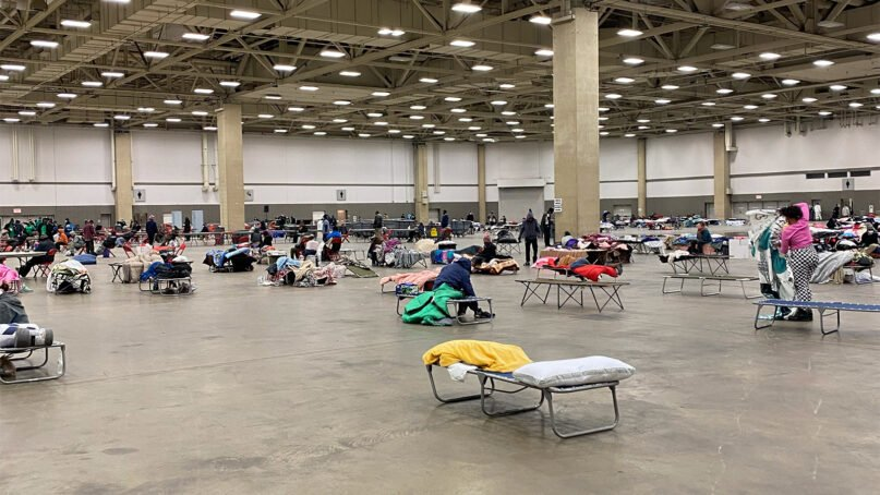 Cots are spread out around an emergency warming center within the Kay Bailey Hutchison Convention Center in Dallas Feb. 16, 2021. Photo courtesy of Ali Hendricksen/OurCalling