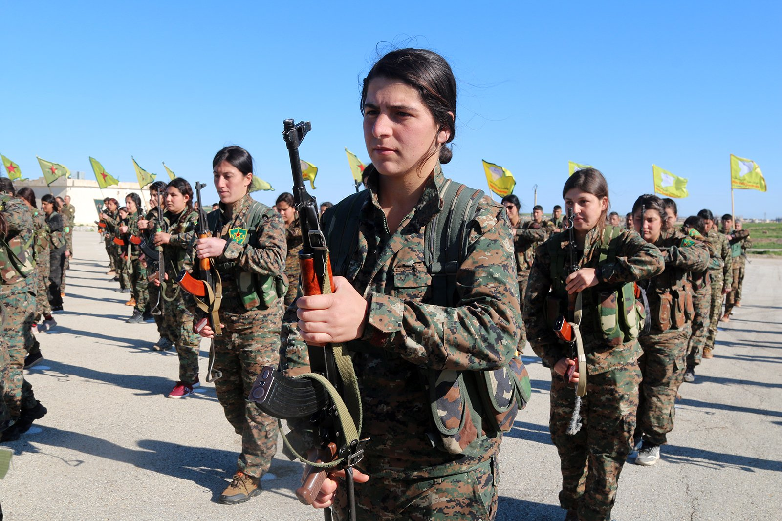 """All-female militia fighting against the Islamic State stand in formation. Photo courtesy of """"The Daughters of Kobani"""""""