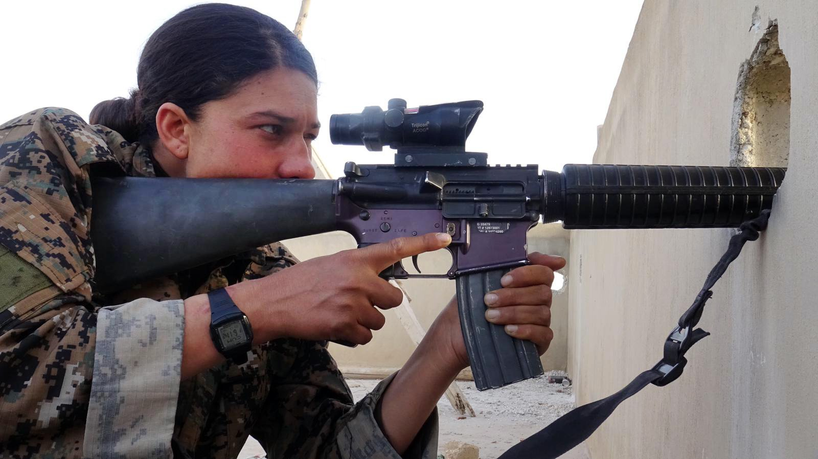 """A YPJ sharpshooter scans for IS fighters. Photo courtesy of """"The Daughters of Kobani"""""""