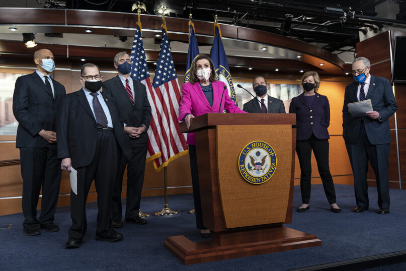 House Speaker Nancy Pelosi of California, center, speaks about the Congress Equality Act on Feb. 25, 2021, with, from left, Sen. Cory Booker, D-N.J.; Sen. Jerry Nadler, D-N.Y.; Sen. Jeff Merkley, D-Ore.; Rep. David Cicilline, D-R.I.; Sen. Tammy Baldwin, D-Wis.; and Senate Majority Leader Chuck Schumer, D-N.Y., on Capitol Hill in Washington. (AP Photo/Jacquelyn Martin)