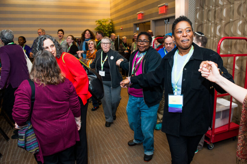 Rabbi Sandra Lawson, right, dances with others during Reconstructing Judaism's 2018 Convention in Philadelphia in Nov. 2018 —  the year she was ordained. Photo by Jordan Cassway