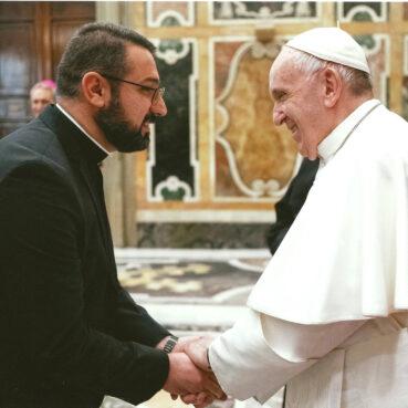 The Rev. Karam Qasha, left, meets Pope Francis. Photo via Facebook