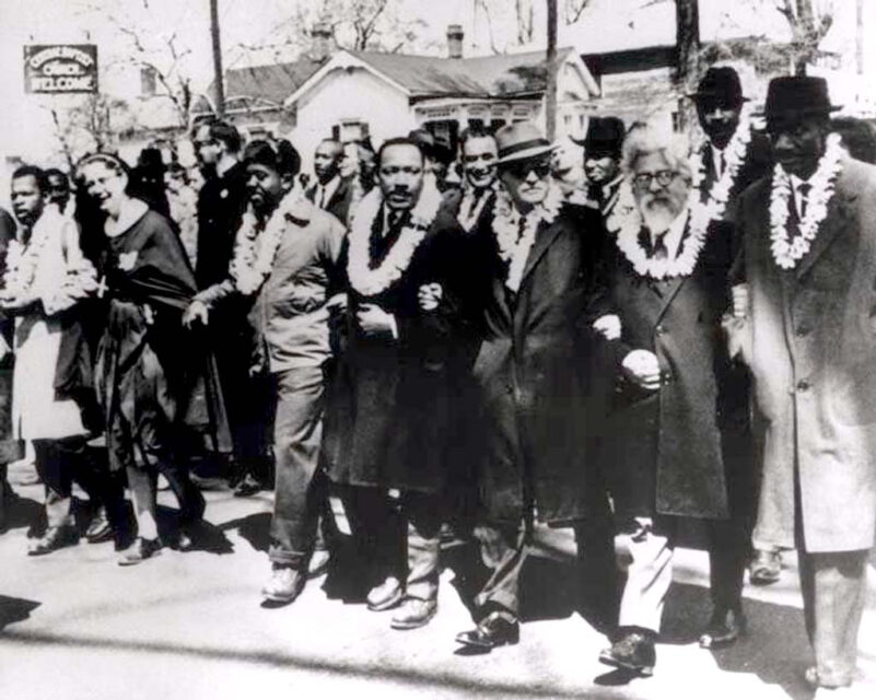 The Rev. Martin Luther King Jr., center, and Rabbi Abraham Joshua Heschel, second from right, march from Selma to Montgomery, Alabama, March 21, 1965. Courtesy of Susannah Heschel