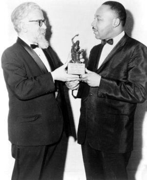 Rabbi Abraham Joshua Heschel, left, presents the Judaism and World Peace award to Dr. Martin Luther King Jr., on Dec. 7, 1965. Photo courtesy of LOC/Creative Commons
