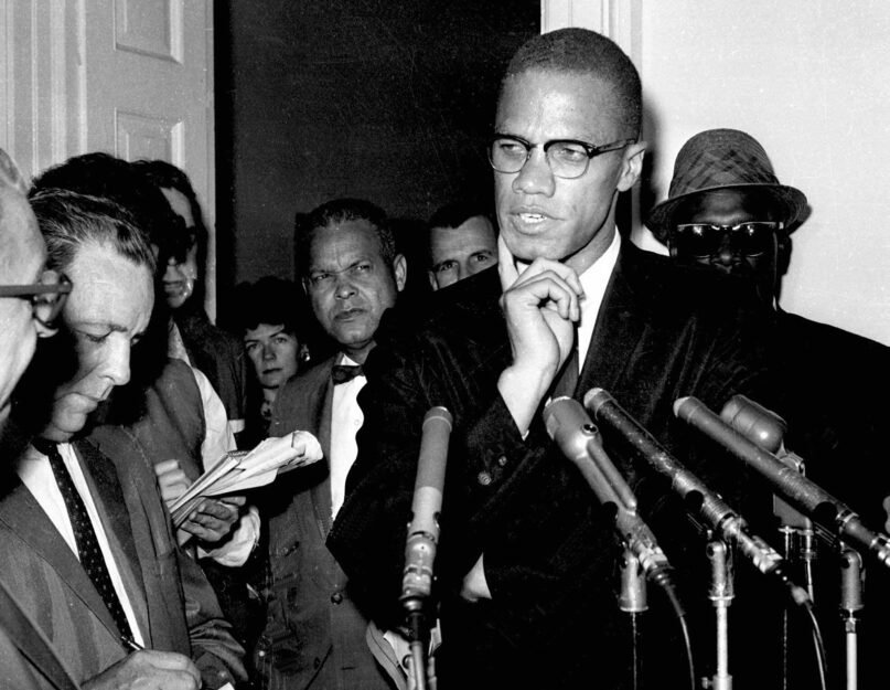 In this May 16, 1963, file photo, civil rights leader Malcolm X speaks to reporters in Washington, D.C. (AP Photo/file)