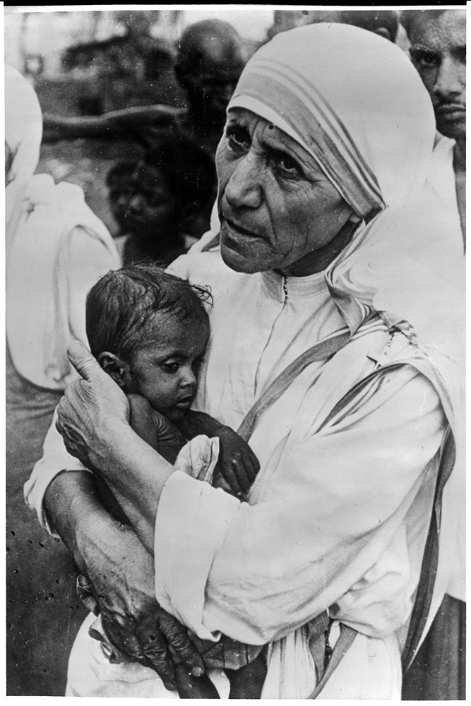 Mother Teresa holds a child in 1971. RNS archive photo. Photo courtesy of the Presbyterian Historical Society