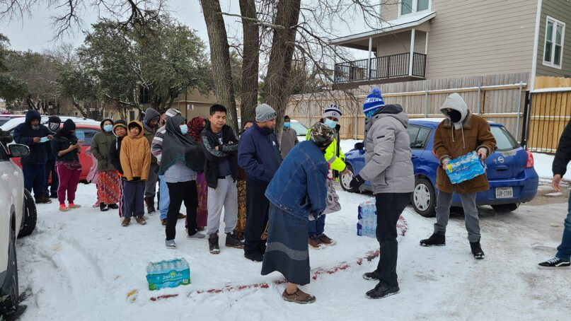 Ma'ruf Dallas distributes water in Dallas on Feb. 17, 2021, after dangerous winter weather hit Texas. Photo courtesy of Ma'ruf Dallas