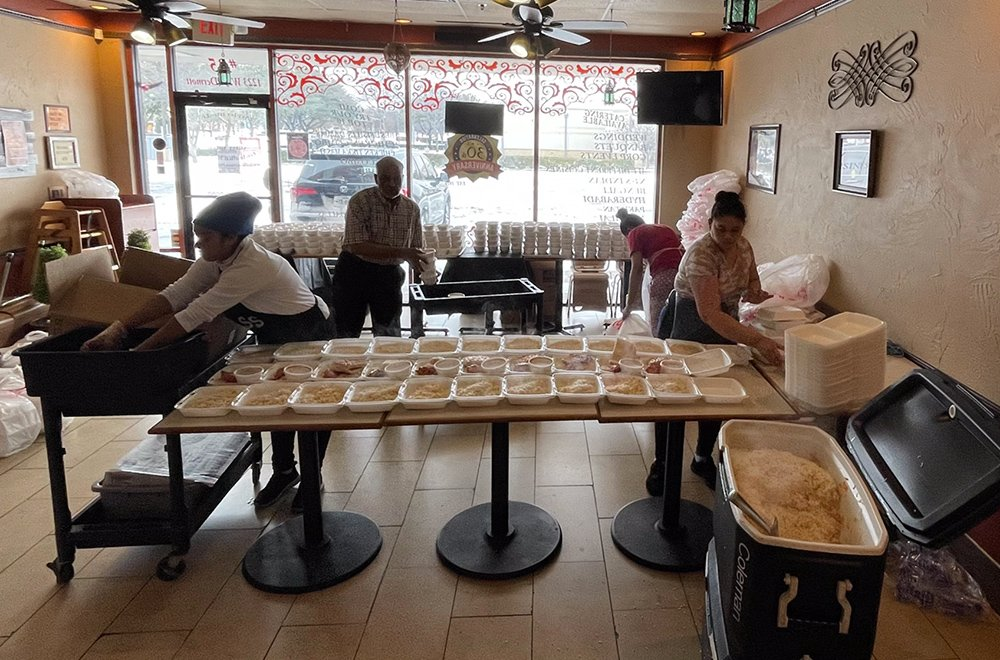 Staff at Silver Spoon Restaurant prepare hot meals for storm victims in Dallas. Photo courtesy of Silver Spoon