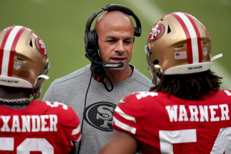 In this Sept. 13, 2020, file photo, San Francisco 49ers defensive coordinator Robert Saleh talks to players on the sideline during the team's NFL football game against the Arizona Cardinals in Santa Clara, Calif. The New York Jets' new head coach is charged with turning around the fortunes of a franchise that has missed out on the playoffs the past 10 seasons — the NFL's longest active drought — and has a few generations of frustrated fans impatiently waiting for at least a chance at another Super Bowl. After all, it has been 52 years and counting. (AP Photo/Scot Tucker, File)