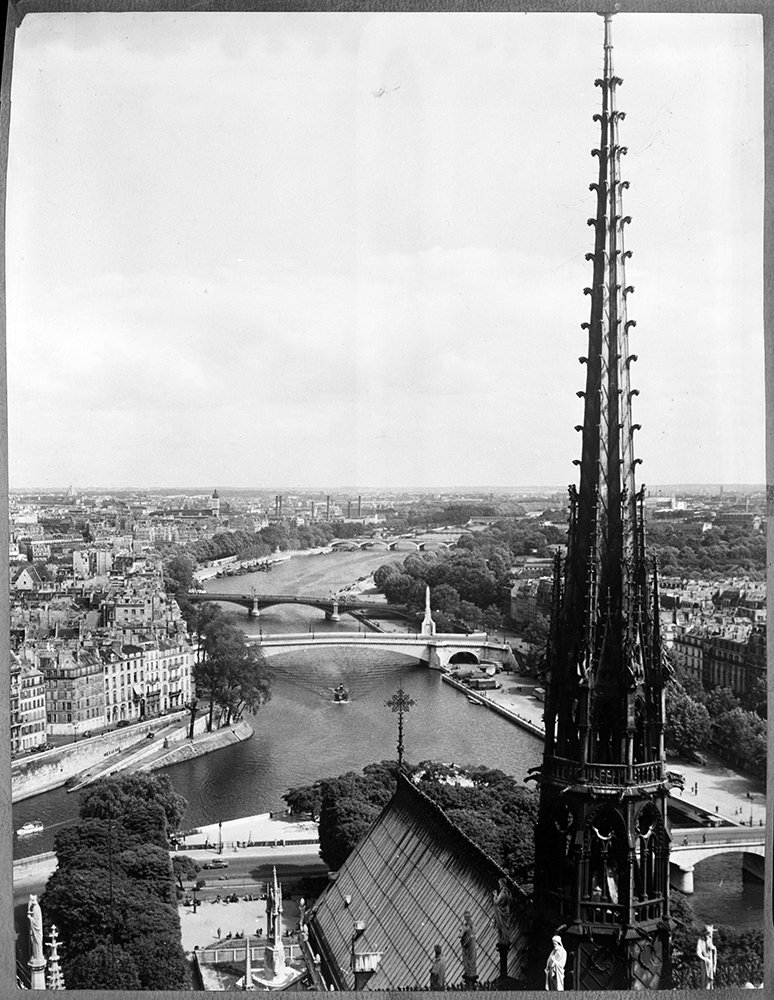The spire from the top of the Notre Dame Cathedral, looking toward the Seine river, in Paris, France, August 1955. Fisherman along the river on a Sunday afternoon. RNS archive photo by Jean Littlefield. Photo courtesy of the Presbyterian Historical Society