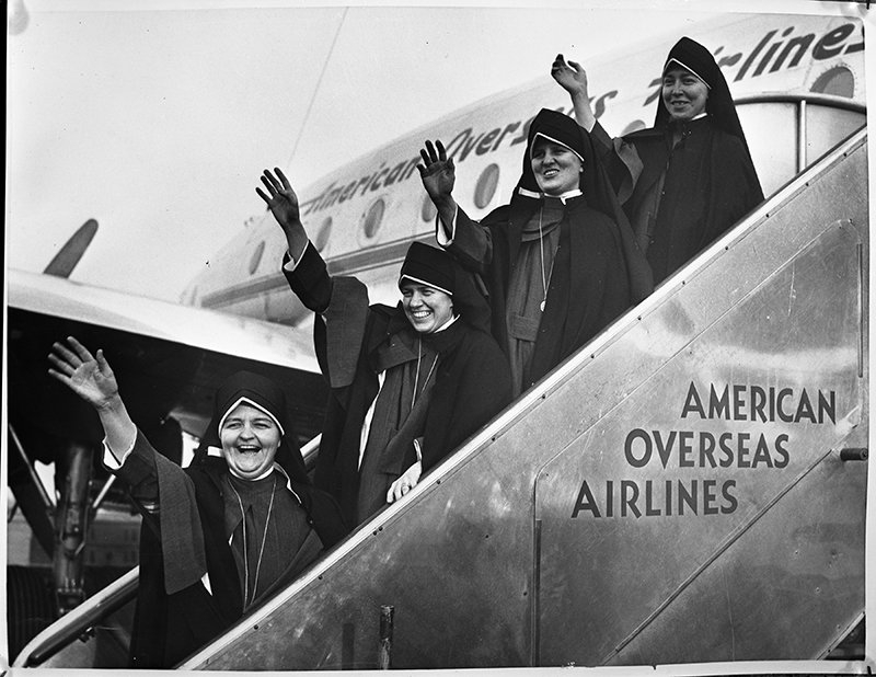 Four Maryknoll sisters board a plane in New York to depart for Tanganyika to begin their mission work, circa 1948. Tanganyika is largely present-day Tanzania in eastern Africa. RNS archive photo.