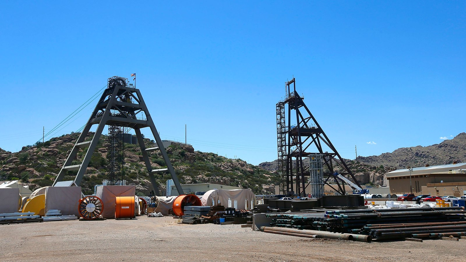 This file photo taken June 15, 2015, shows the Resolution Copper Mining area Shaft #9, right, and Shaft #10, left, that await the expansion go ahead in Superior, Ariz. The U.S. Forest Service released an environmental review Friday, Jan. 15, 2021, that paves the way for the creation of one of the largest copper mines in the United States, against the wishes of a group of Apaches who have been trying for years to stop the project. The mountainous land near Superior is known as Oak Flat or Chi'chil Bildagoteel. It's where Apaches have harvested medicinal plants, held coming-of-age ceremonies, and gathered acorns for generations. (AP Photo/Ross D. Franklin, File)