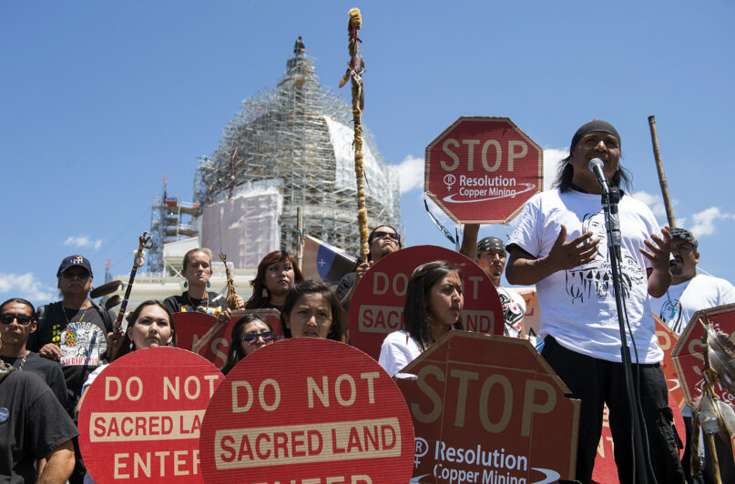 In this July 22, 2015, file photo, tribal councilman Wendsler Nosie Sr., right, speaks with Apache activists in a rally to save Oak Flat, land near Superior, Arizona, sacred to Western Apache tribes, in front of the U.S. Capitol in Washington. A group of Apaches who have tried for years to reverse a land swap in Arizona that will make way for one of the largest and deepest copper mines in the U.S. sued the federal government Jan. 12, 2021. Apache Stronghold argues in the lawsuit filed in U.S. District Court in Arizona that the U.S. Forest Service cannot legally transfer land to international mining company Rio Tinto in exchange for eight parcels the company owns around Arizona. (AP Photo/Molly Riley, File)
