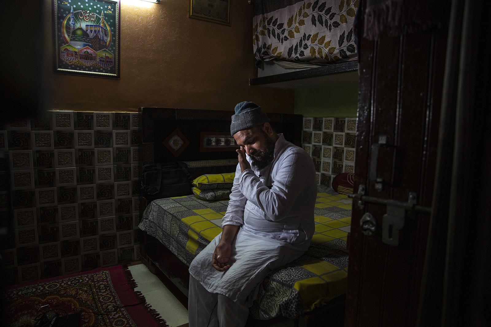 Haroon, who saw his 32 year-old brother being shot and killed by his Hindu neighbors during the February 2020 communal riots, breaks down while speaking to Associated Press inside his home in North Ghonda, one of the worst riot affected neighborhoods, in New Delhi, India, Friday, Feb. 19, 2021. As the first anniversary of bloody communal riots that convulsed the Indian capital approaches, Muslim victims are still shaken and struggling to make sense of their struggle to seek justice. (AP Photo/Altaf Qadri)