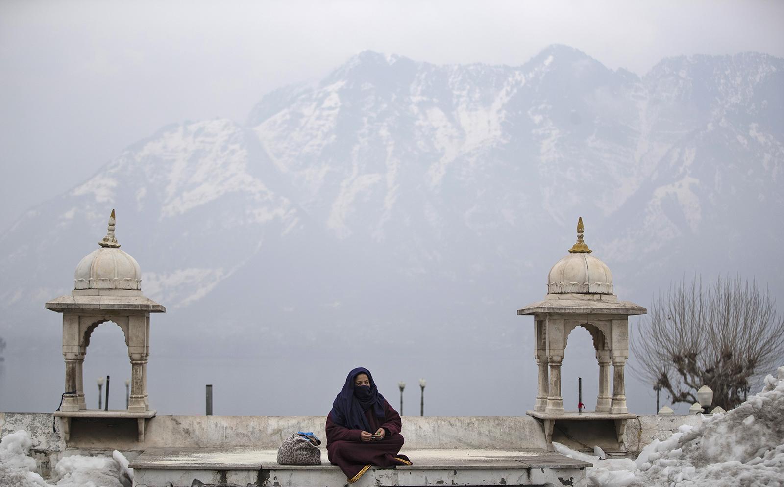 A Kashmiri Muslim woman prays outside Hazratbal Shrine after special prayers on the death anniversary of Abu Bakr Siddiq, the first Caliph of Islam, at Hazratbal Shrine in Srinagar, Indian controlled Kashmir, Friday, Feb. 5, 2021. (AP Photo/Mukhtar Khan)