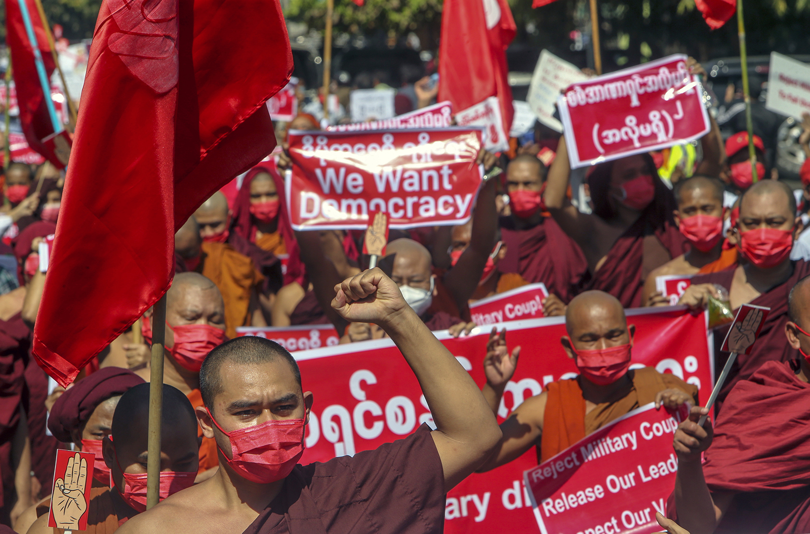 Buddhist monks lead a protest march against the military coup in Mandalay, Myanmar, on Wed., Feb. 10, 2021. Protesters continued to gather Wednesday morning in Mandalay breaching Myanmar's new military rulers' decrees that effectively banned peaceful public protests in the country's two biggest cities. (AP Photo)