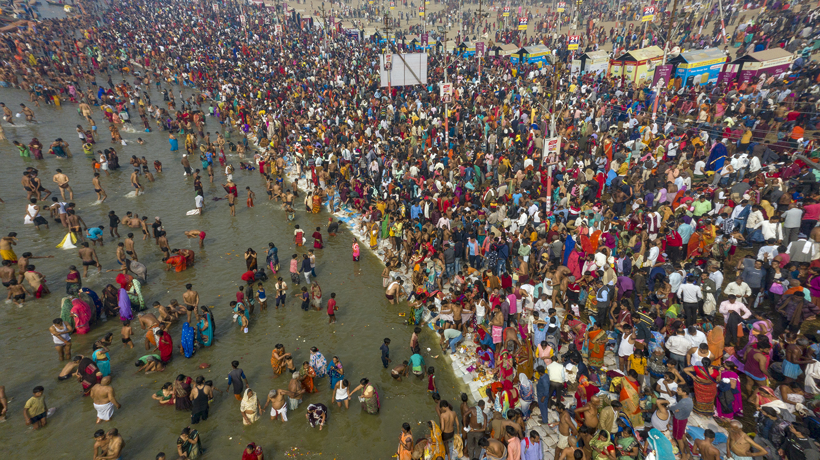 """Thousands of Hindu devotees bathe at the Sangam, the confluence of the rivers Ganges and the Yamuna, during the annual month-long Hindu religious fair """"Magh Mela"""" in Prayagraj, India, on Thursday, Feb. 11, 2021. (AP Photo/Rajesh Kumar Singh)"""