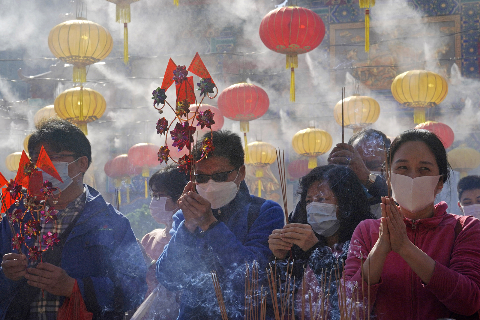 Buddhist worshippers burn joss sticks as they pray at the Wong Tai Sin Temple, in Hong Kong, Friday, Feb. 12, 2021, to celebrate the Lunar New Year, which marks the Year of the Ox in the Chinese zodiac. (AP Photo/Kin Cheung)