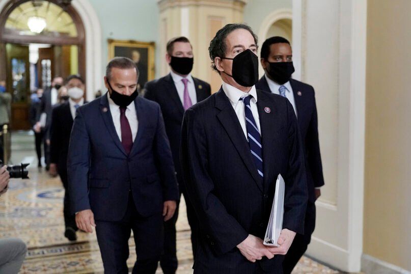 Democratic House impeachment managers, from left, Rep. David Cicilline, D-R.I., Rep. Eric Swalwell, D-Calif., Rep. Jamie Raskin, D-Md., and Rep. Joe Neguse, D-Colo., walk out of the Senate Chamber in the Capitol at the end of the fifth day of the second impeachment trial of former President Donald Trump, Saturday, Feb. 13, 2021, in Washington. The Senate acquitted Donald Trump of inciting the Jan. 6 attack on the U.S. Capitol, bringing his trial to a close and giving the former president a historic second victory in the court of impeachment. (AP Photo/J. Scott Applewhite)