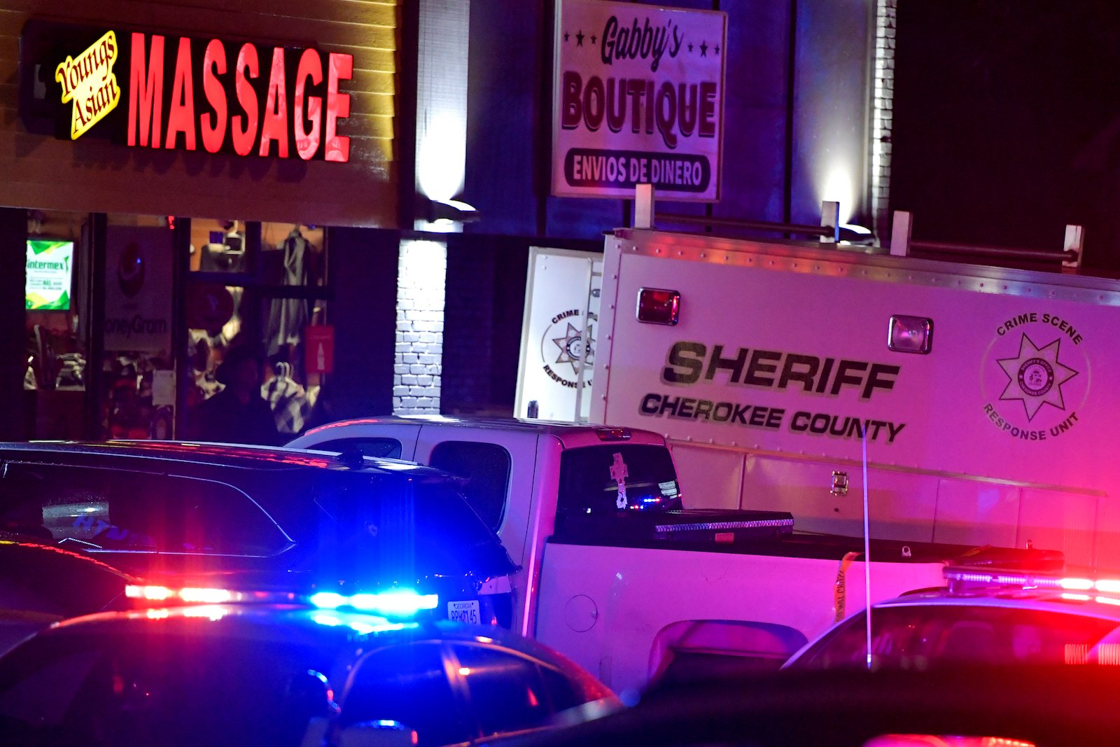 Authorities investigate a multiple fatal shooting at a spa March 16, 2021, in Acworth, Georgia. Cherokee County sheriff's Capt. Jay Baker said Robert Aaron Long of Woodstock, Georgia, was taken into custody in Crisp County on Tuesday night. (AP Photo/Mike Stewart)