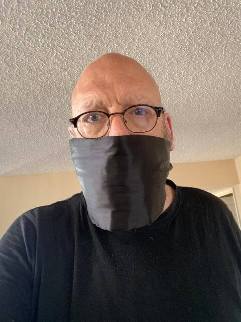 The author using a cumerbund as a mask, because it is not as if I would be attending a formal affair any time soon