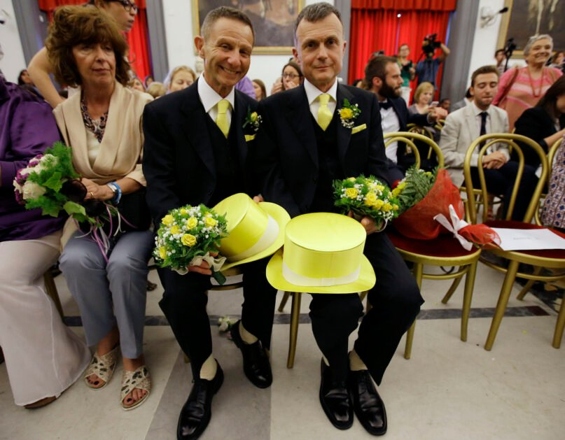 """FILE - In this May 21, 2015 file photo, Angelo Albanesi, left, and Pier Giorgio De Simone wait for their civil union to be registered by a municipality officer during a ceremony in Rome's Campidoglio Capitol Hill. The Vatican has decreed, Monday, March 15, 2021, that the Catholic Church cannot bless same-sex unions since God """"cannot bless sin."""" The Vatican's orthodoxy office, the Congregation for the Doctrine of the Faith, issued a formal response to a question about whether Catholic clergy can bless gay unions. (AP Photo/Gregorio Borgia, file)"""