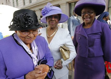 FILE - In this April 27, 2010, file photo milliner Vanilla P. Beane, 90, left, talks about her friendship with the late Dorothy Height, a leading female voice of the 1960s civil rights movement, outside the National Council of Negro Women building in Washington, where Height's casket arrived for public viewing. When Height died at age 98 this spring, some of her friends and admirers wore hats to her funeral as a final tribute, Beane among them. And many of the women also wore purple, Height's favorite color. (AP Photo/J. Scott Applewhite, File)