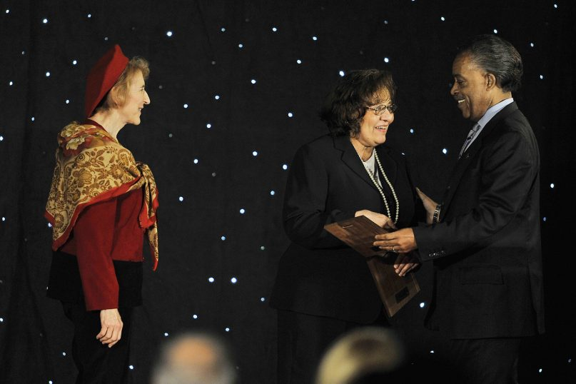 The Rev. Al Sharpton, right, presents plaques to Diane Nash and Carol Ruth Silver, left, as a Tribute to Freedom Riders at the Major League Baseball Beacon Awards Banquet as a part of MLB's Civil Rights Game Weekend at the Omni Hotel, Saturday, May 14, 2011, in Atlanta. (AP Photo/Paul Abell)