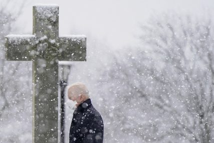 FILE - President Joe Biden departs after attending Mass at St. Joseph on the Brandywine Catholic Church as snow falls, Sunday, Feb. 7, 2021, in Wilmington, Del. President Biden is tasked with selecting a new ambassador to the Holy See to recommend to the Senate for confirmation. (AP Photo/Patrick Semansky)
